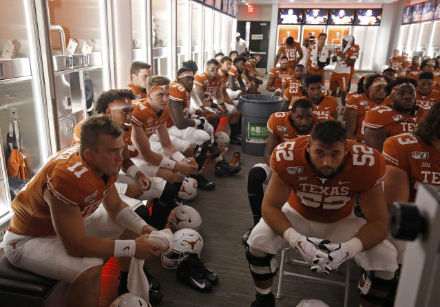 Texas Longhorns players listen to coaches in the locker room at half time during the game against the LSU Tigers Saturday Sept. 7, 2019 at Darrell K Royal-Texas Memorial Stadium in Austin, Tx. ( Photo by Edward A. Ornelas )