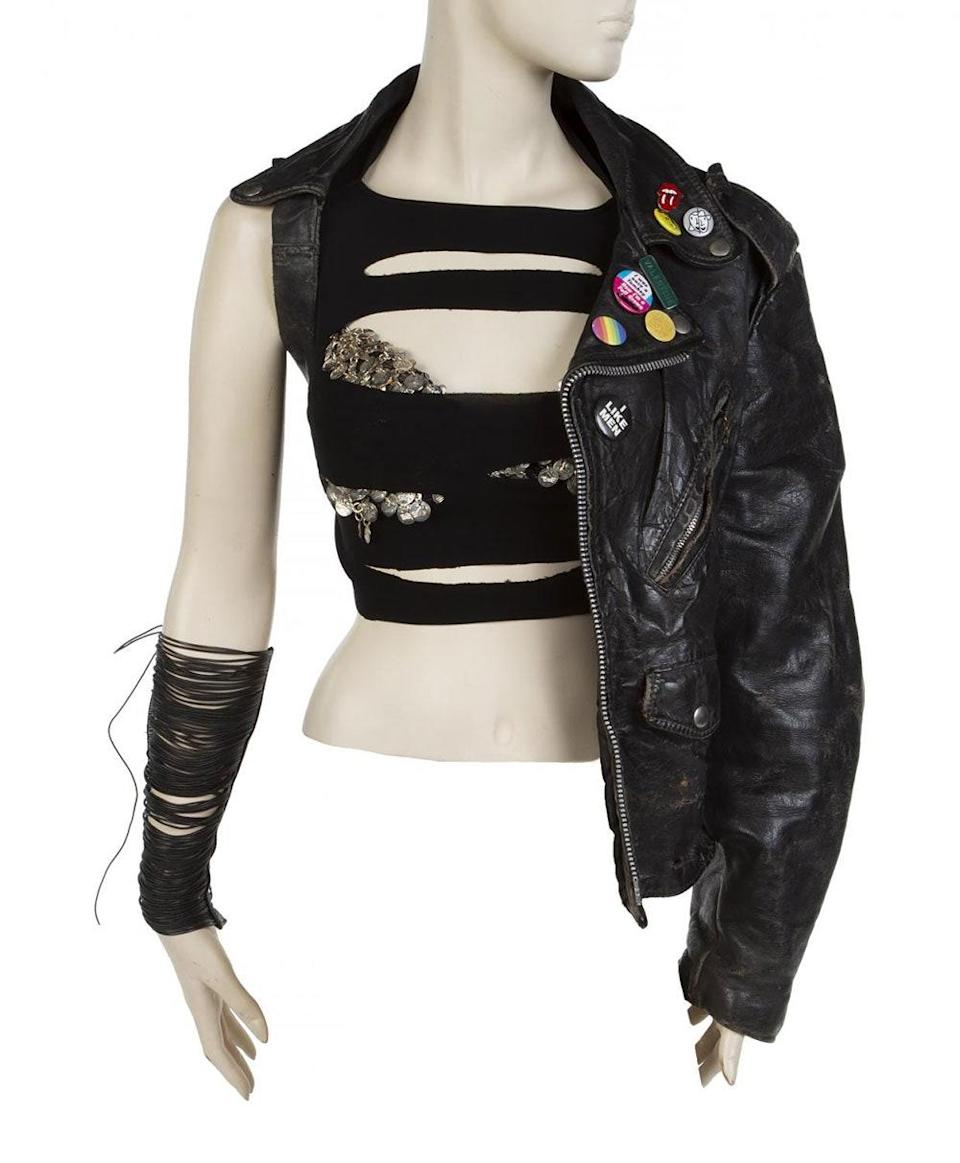 The video's black leather half-jacket and push up bra.