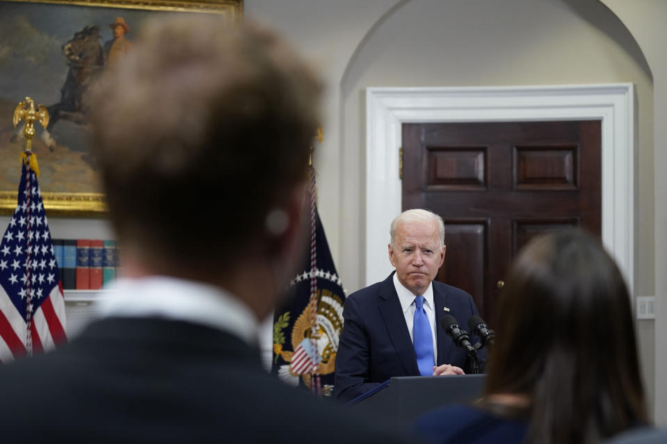 FILE - In this May 13, 2021, file photo President Joe Biden responds to questions from the media after delivering remarks about the Colonial Pipeline hack, in the Roosevelt Room of the White House in Washington. The Centers for Disease Control and Prevention said Thursday that fully vaccinated people — those who are two weeks past their last required dose of a COVID-19 vaccine — can stop wearing masks outdoors in crowds and in most indoor settings. Across Washington, the government is adjusting in a variety of ways to new federal guidance easing up on when face masks should be worn. (AP Photo/Evan Vucci, File)
