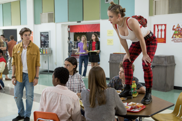 Sydney Sweeney, standing on a cafeteria lunch table, as Emaline in <em>Everything Sucks!</em> (Photo: Scott Patrick Green/Netflix)
