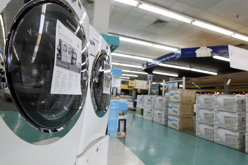 In this April 27, 2012 photo, washing machines and air conditioners line the aisles of a Cowboy Maloney's Electric City Superstore in Jackson, Miss. The Commerce Department reports on business orders for durable goods in May, on Tuesday, June 25, 2013. (AP Photo/Rogelio V. Solis)