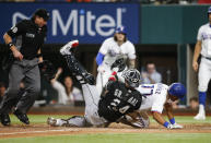 Chicago White Sox catcher Yasmani Grandal (24) tags out Texas Rangers' Andy Ibanez (77) during the sixth inning of a baseball game, Saturday, Sept. 18, 2021, in Arlington, Texas. (AP Photo/Brandon Wade)