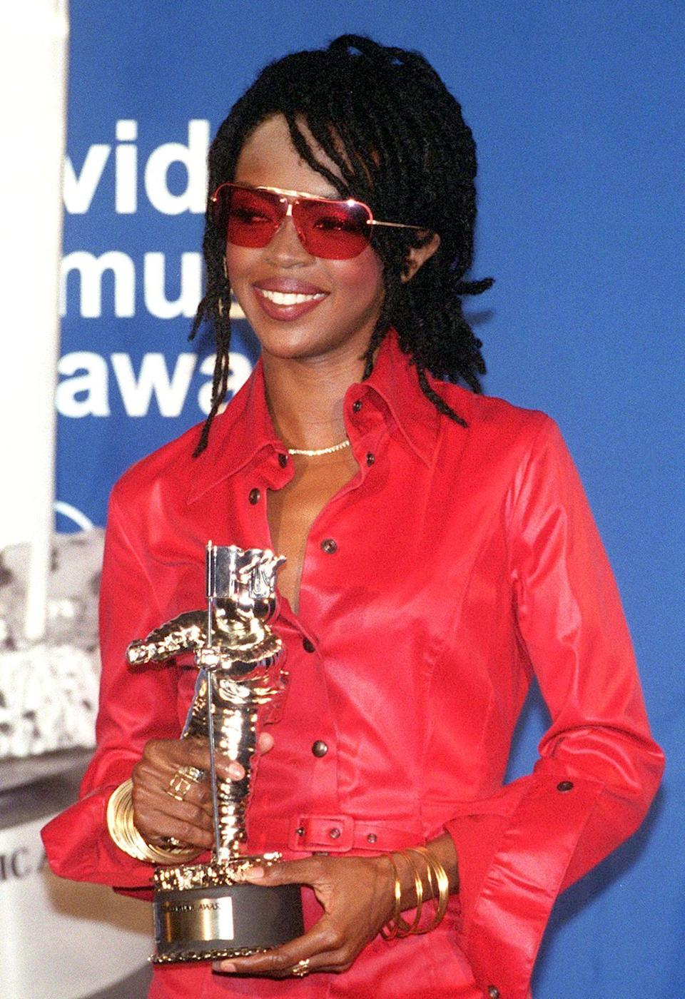 Lauryn Hill is the epitome of cool — which this red-on-red ensemble (with perfectly coordinating lip) proves.