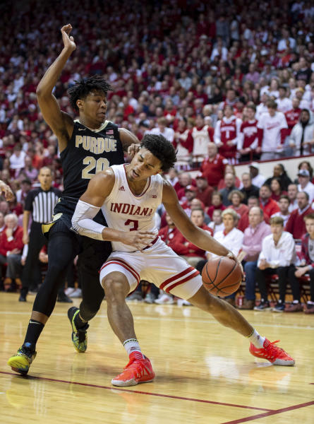 Indiana forward Justin Smith (3) makes contact with Purdue guard Nojel Eastern (20) as he drives the ball towards the basket during the first half of an NCAA college basketball game, Saturday, Feb. 8, 2020, in Bloomington, Ind. (AP Photo/Doug McSchooler)