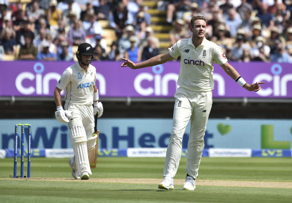 England's Stuart Broad, right, reacts after bowling a delivery during the second day of the second cricket test match between England and New Zealand at Edgbaston in Birmingham, England, Friday, June 11, 2021. (AP Photo/Rui Vieira)