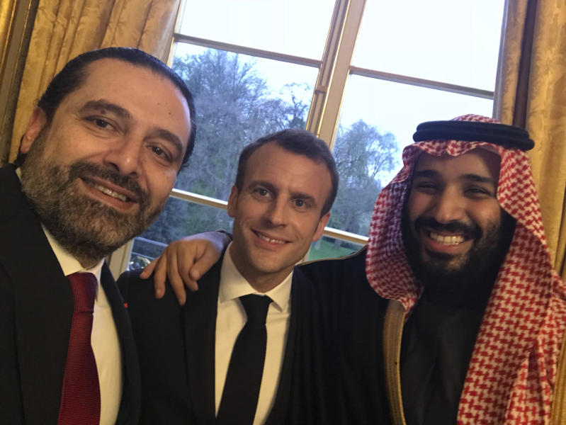 FILE - This photo released on the official twitter page of Lebanese Prime Minister Saad Hariri on Monday, April 9, 2018, shows Hariri, left, taking a selfie photo with French President Emmanuel Macron, center, and Saudi Arabia's Crown Prince Mohammed bin Salman, right, in the King George V Hotel, in Paris, France. (Saad Hariri via AP)