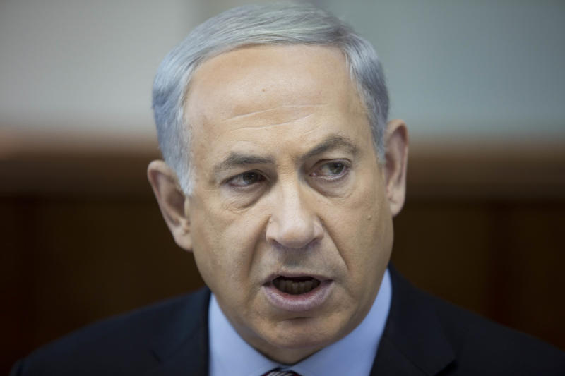 Israeli Prime Minister Benjamin Netanyahu attends the weekly cabinet meeting at his office in Jerusalem, Israel, Sunday, Nov. 24, 2013. After feverishly trying to derail the international community's nuclear deal with Iran in recent weeks, Israeli Prime Minister Benjamin Netanyahu now has little choice but to accept an agreement that he has derided as deeply flawed. (AP Photo/Abir Sultan, Pool)