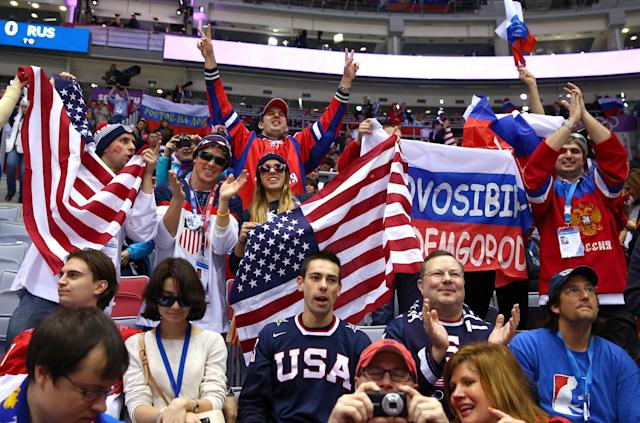 SOCHI, RUSSIA - FEBRUARY 15: American and Russian fans attend the Men's Ice Hockey Preliminary Round Group A game between Russia and the United States on day eight of the Sochi 2014 Winter Olympics at Bolshoy Ice Dome on February 15, 2014 in Sochi, Russia. (Photo by Streeter Lecka/Getty Images)
