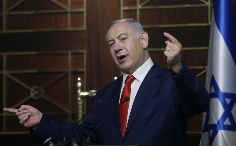 FILE - In this Tuesday, Aug. 20, 2019 file photo, Israeli Prime Minister Benjamin Netanyahu delivers a speech in Kyiv, Ukraine. The long shadow war between Israel and Iran has burst into the open in recent days, with Israel allegedly striking Iran-linked targets as far away as Iraq and crash-landing two drones in Lebanon. These incidents, along with an air raid in Syria that Israel says thwarted an imminent Iranian drone attack, have raised tensions at a particularly fraught time. (AP Photo/Efrem Lukatsky, File)