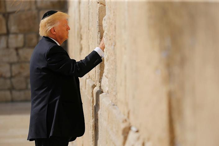 <p>U.S. President Donald Trump places a note in the stones of the Western Wall, Judaism's holiest prayer site, in Jerusalem's Old City on May 22, 2017. (Photo: Jonathan Ernst/Reuters) </p>