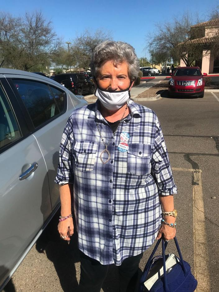 Linda Cottrell stands in a parking lot after voting in Arizona.