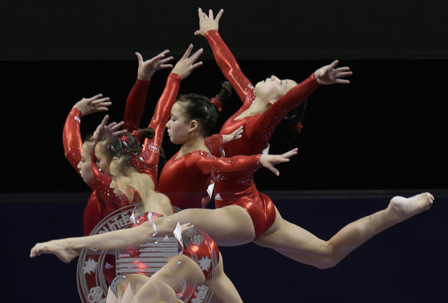 In this multiple exposure frame taken at one-fourth second intervals, Sarah Finnegan performs on the balance beam during the preliminary round of the women's Olympic gymnastics trials, Friday, June 29, 2012, in San Jose, Calif. (AP Photo/Julie Jacobson)