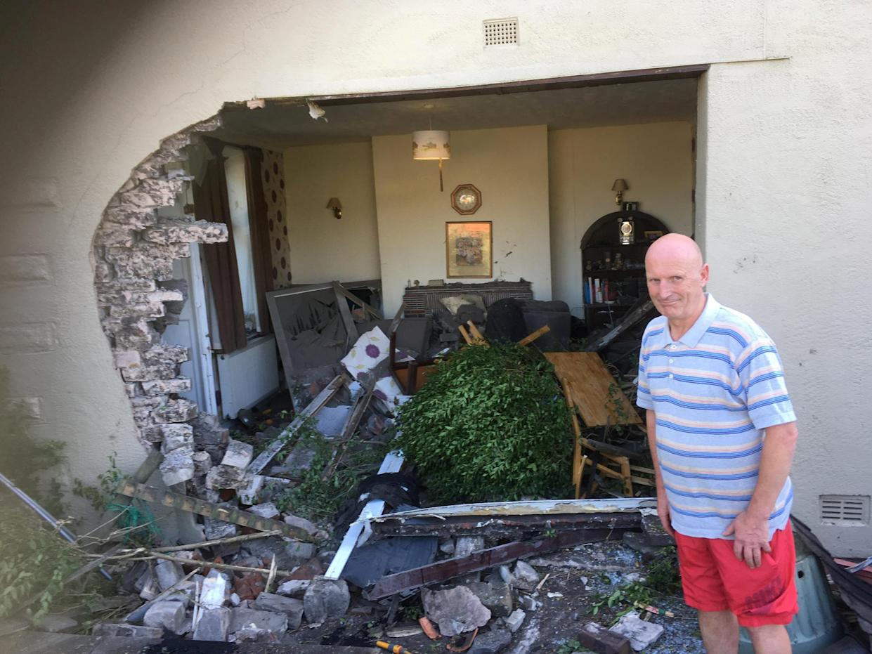 <em>Devastation – a car left a giant hole in the side of Tony Ross' house after ploughing into it (Picture: SWNS)</em>