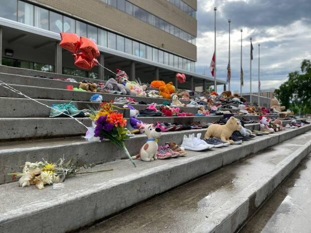 A memorial to Indigenous children who died at residential schools on the steps of Prince George, B.C., city hall is being taken into storage by the Exploration Place museum while the Lheidli T'enneh First Nation finds a permanent home for it. (Andrew Kurjata/CBC - image credit)
