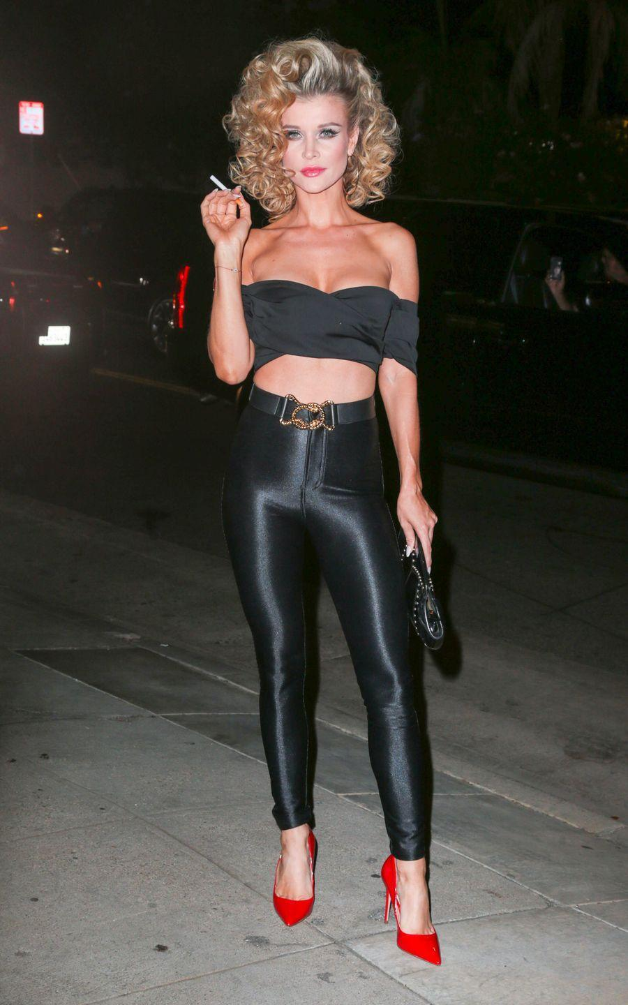 """<p>Sandy from <em>Grease</em> is a Halloween costume staple, and for good reason — it looks great and can usually be thrown together with items you already own. Just pair black leather leggings with a black bustier top and complete the look with a red heels. </p><p><strong>What You'll Need:</strong> <a href=""""https://www.amazon.com/Everbellus-Womens-Leather-Waisted-Leggings/dp/B015IO2VYK?tag=syn-yahoo-20&ascsubtag=%5Bartid%7C10070.g.28166042%5Bsrc%7Cyahoo-us"""" rel=""""nofollow noopener"""" target=""""_blank"""" data-ylk=""""slk:black leather leggings"""" class=""""link rapid-noclick-resp"""">black leather leggings</a>, <a href=""""https://www.amazon.com/Womens-Strapless-Shoulder-Ruffled-T-shirt/dp/B06Y43FQCF?tag=syn-yahoo-20&ascsubtag=%5Bartid%7C10070.g.28166042%5Bsrc%7Cyahoo-us"""" rel=""""nofollow noopener"""" target=""""_blank"""" data-ylk=""""slk:black top"""" class=""""link rapid-noclick-resp"""">black top</a>, and <a href=""""https://www.amazon.com/DREAM-PAIRS-Classic-Fashion-Pointed/dp/B0785HTBLT?tag=syn-yahoo-20&ascsubtag=%5Bartid%7C10070.g.28166042%5Bsrc%7Cyahoo-us"""" rel=""""nofollow noopener"""" target=""""_blank"""" data-ylk=""""slk:red heels"""" class=""""link rapid-noclick-resp"""">red heels</a></p>"""