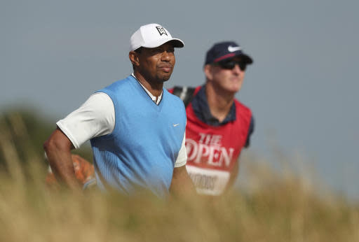 Tiger Woods of the US and his caddie Joe Lacava walk along the 7the fairway during the first round of the British Open Golf Championship in Carnoustie, Scotland, Thursday July 19, 2018. (AP Photo/Jon Super)