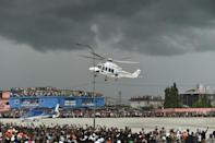 President Alassane Ouattara used a helicopter to make a dramatic appearance at his final rally on Thursday