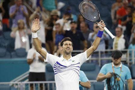 Mar 24, 2019; Miami Gardens, FL, USA; Novak Djokovic of Serbia celebrates after his match against Federico Delbonis of Argentina (not pictured) in the third round of the Miami Open at Miami Open Tennis Complex. Mandatory Credit: Geoff Burke-USA TODAY Sports