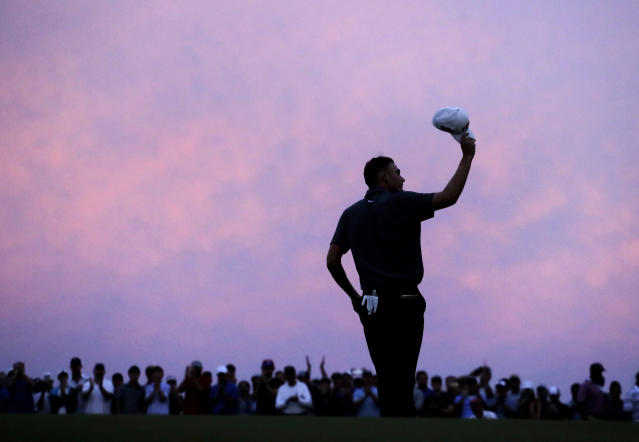 Aaron Wise acknowledges applause on the 18th green after winning the AT&T Byron Nelson golf tournament in Dallas, Sunday, May 20, 2018. (AP Photo/Eric Gay)