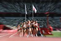 <p>Athletes compete in the women's 3000m steeplechase heats during the Tokyo 2020 Olympic Games at the Olympic Stadium in Tokyo on August 1, 2021. (Photo by Jewel SAMAD / AFP)</p>