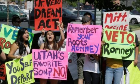 Immigration activists protest outside The Grand America in Salt Lake City, Utah, where Mitt Romney holds a campaign event on Sept. 18.