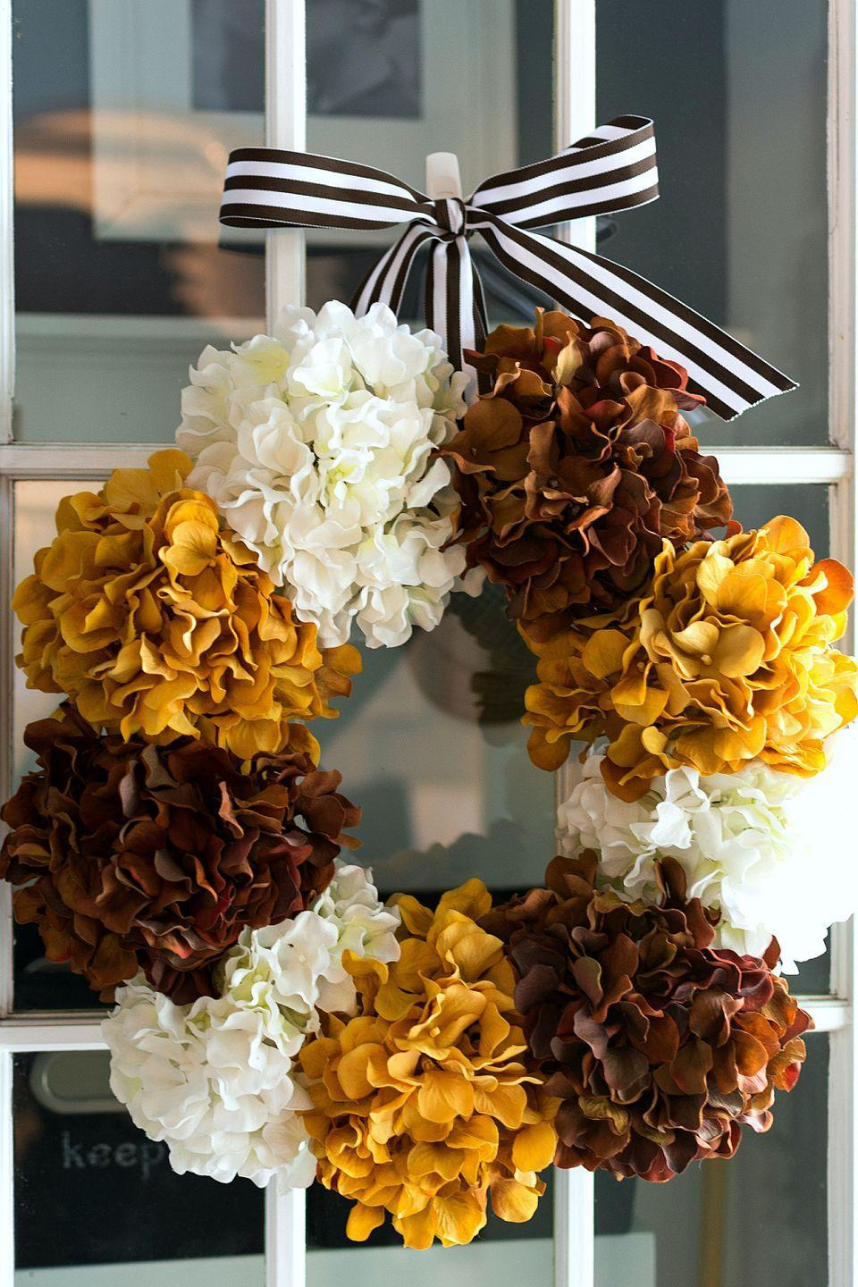 """<p>Bold hydrangeas will make your door the focal point of your front porch. </p><p><strong>Get the tutorial at <a href=""""http://www.itallstartedwithpaint.com/hydrangea-wreath-for-fall/"""" rel=""""nofollow noopener"""" target=""""_blank"""" data-ylk=""""slk:It All Started with Paint"""" class=""""link rapid-noclick-resp"""">It All Started with Paint</a>.</strong> </p>"""