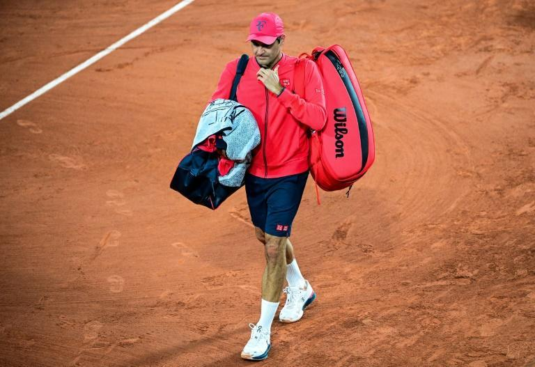 Walk away in silence: Roger Federer leaves the court after defeating Dominik Koepfer