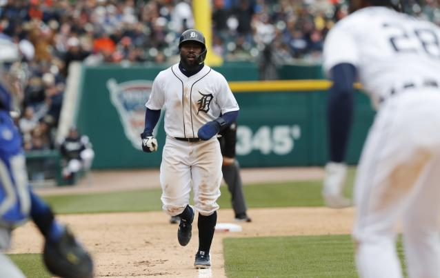Detroit Tigers' Josh Harrison heads home as Niko Goodrum (28) draws a bases loaded walk during the seventh inning of a baseball game against the Kansas City Royals, Thursday, April 4, 2019, in Detroit. (AP Photo/Carlos Osorio)