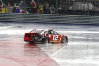 Ryan Blaney (12) spins in Turn 12 during the NASCAR Cup Series auto race at the Circuit of the Americas in Austin, Texas, Sunday, May 23, 2021. (AP Photo/Chuck Burton)