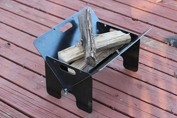 """This handcrafted fire pit is made from steel and metal—it's also completely portable. It's only 30 pounds and collapses down to a mere inch. $120, Etsy. <a href=""""https://www.etsy.com/listing/564420132/minimalist-modern-fire-pit-wedge-style"""" rel=""""nofollow noopener"""" target=""""_blank"""" data-ylk=""""slk:Get it now!"""" class=""""link rapid-noclick-resp"""">Get it now!</a>"""