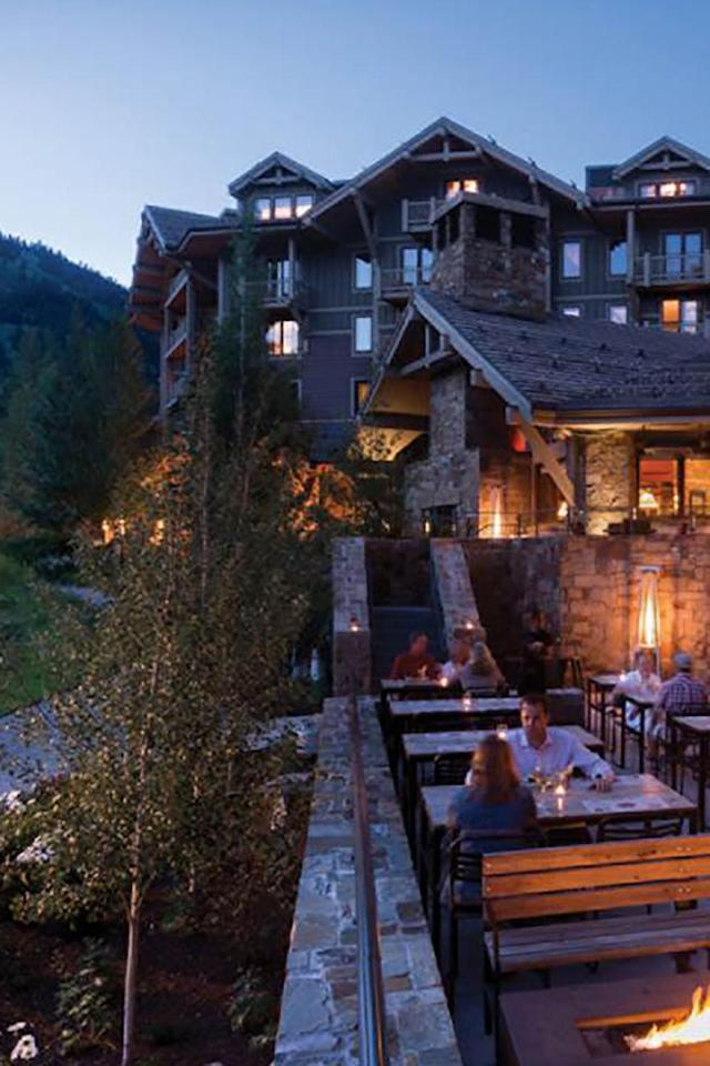 """<p>Sometimes the best way to unwind from a day full of strenuous ski exercise is...with more exercise. <a href=""""http://www.fourseasons.com/jacksonhole/"""" rel=""""nofollow noopener"""" target=""""_blank"""" data-ylk=""""slk:The Four Seasons Jackson Hole"""" class=""""link rapid-noclick-resp"""">The Four Seasons Jackson Hole</a> offers guests a complimentary après ski yoga class to loosen up those sore muscles—you will not believe the kind of relief yoga stretching provides after skiing, especially when you're on a multi day trip.</p><p>After the class, you can continue unwinding by lounging at their outdoor pool and hot tubs, located slope side, where snow bunnies will put your robes on for you and store them in a heated box while you soak. If you end up there during peak aprés time, AKA 3 to 6 p.m., you'll also be able to indulge in poolside s'mores.</p>"""