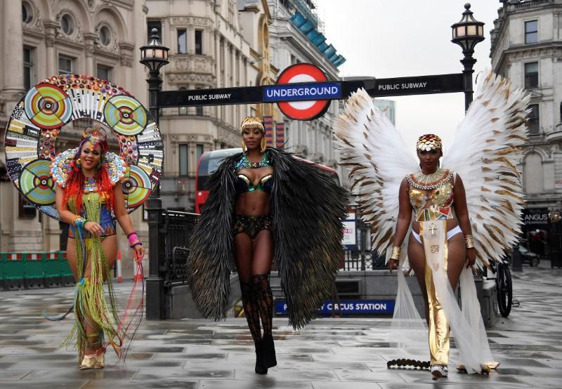 Caribbean soca dancers display costumes as they promote the first ever digital Notting Hill Carnival, following the cancellation of the normal Carnival festivities due to the continued spread of the coronavirus disease (COVID-19), London, Britain
