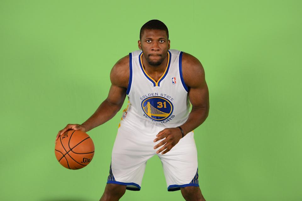 September 27, 2013; Oakland, CA, USA; Golden State Warriors center Festus Ezeli (31) stands in front of a green screen during media day at the Warriors Practice Facility.