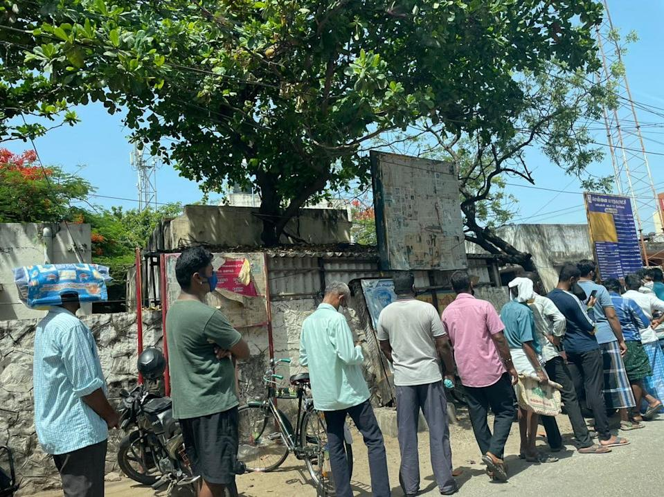 Chennai locals form a queue for ration.