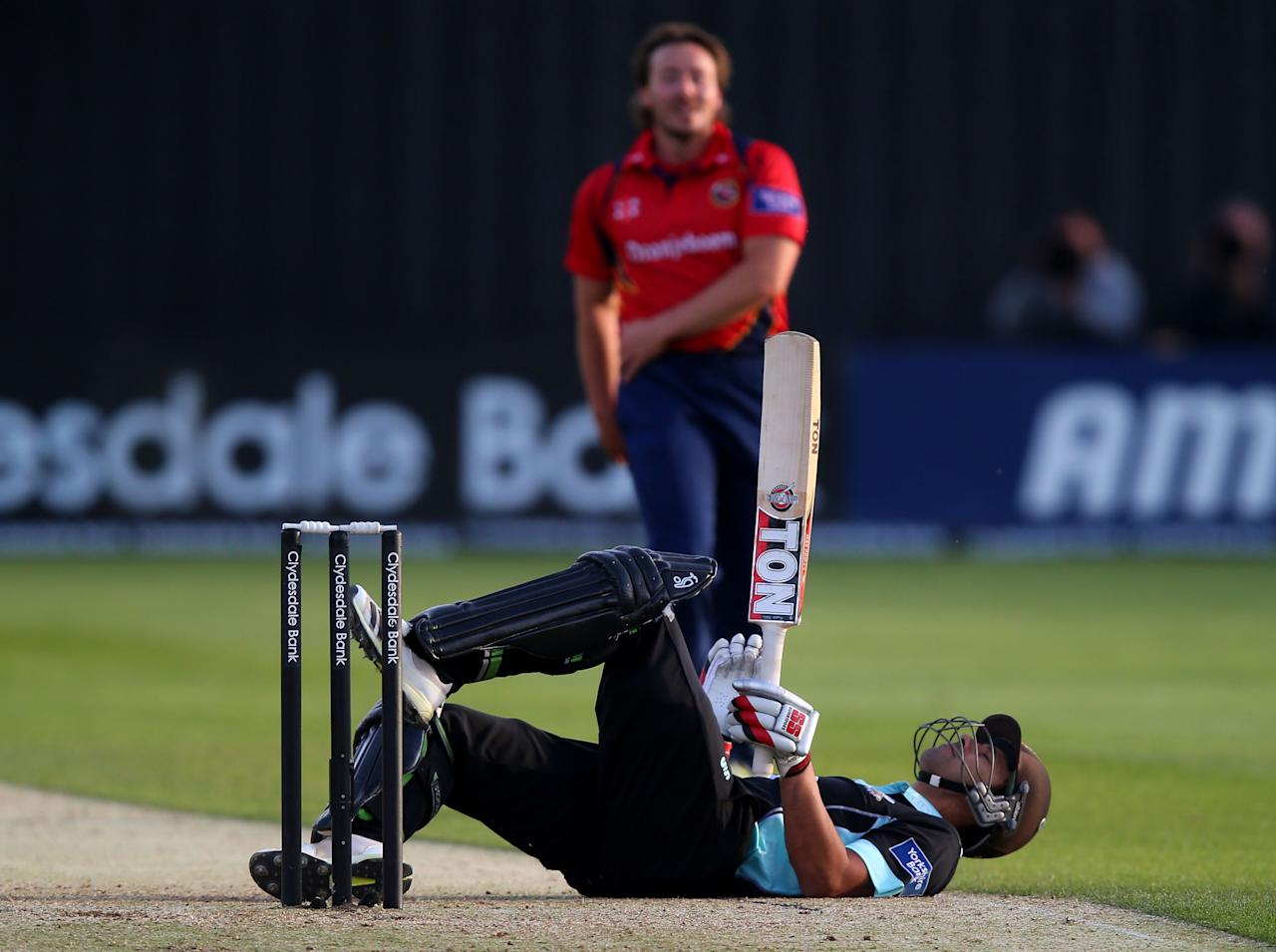 CHELMSFORD, ENGLAND - JUNE 03:  Vikram Solanki of Surrey is knocked to the ground off a delivery from Graham Napier of Essex during the Yorkshire Bank 40 between Essex and Surrey on June 3, 2013 in Chelmsford, England.  (Photo by Clive Rose/Getty Images)