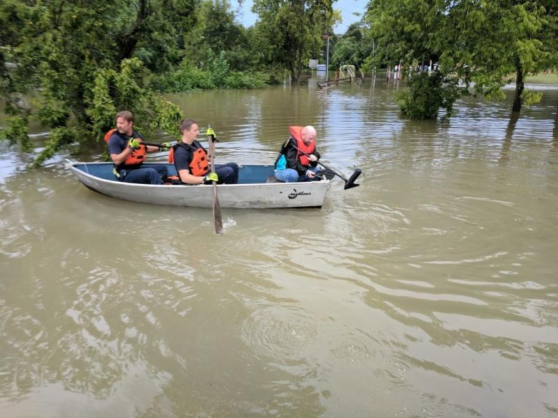 People in a boat following this weekend's heavy rain. (Roque Planas/HuffPost)