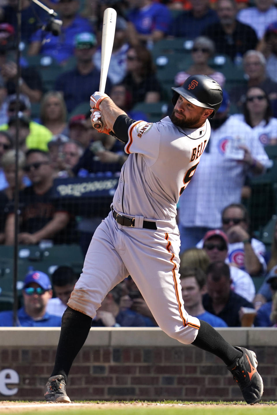 San Francisco Giants' Brandon Belt hits a two-run home run during the seventh inning of a baseball game against the Chicago Cubs in Chicago, Friday, Sept. 10, 2021. (AP Photo/Nam Y. Huh)