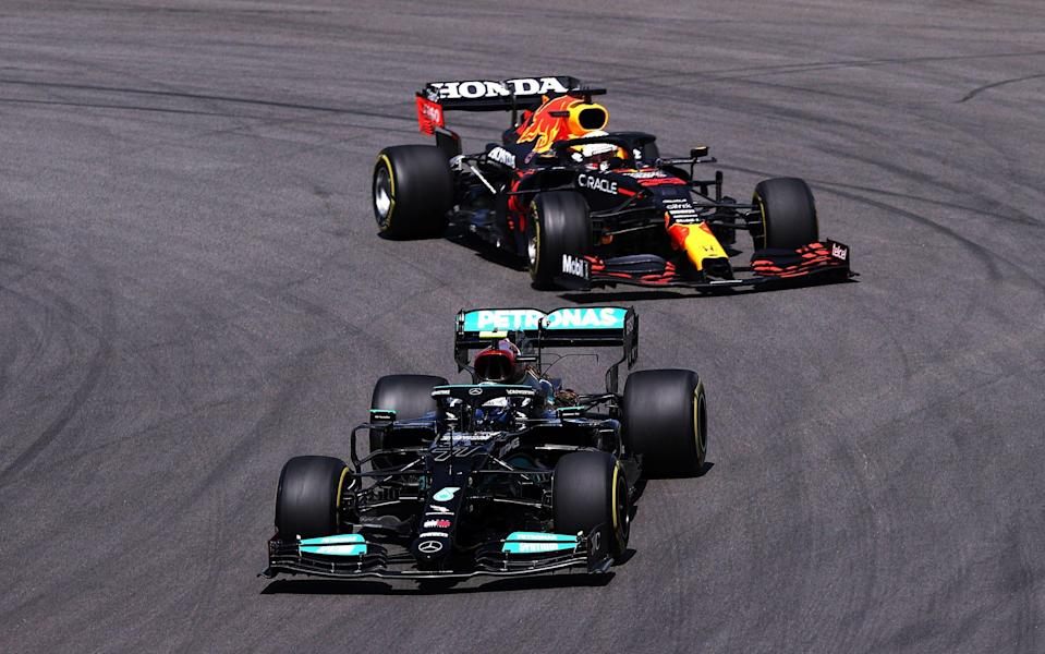 Valtteri Bottas of Finland driving the (77) Mercedes AMG Petronas F1 Team Mercedes W12 leads Max Verstappen of the Netherlands driving the (33) Red Bull Racing RB16B Honda on track during the F1 Grand Prix of Portugal at Autodromo Internacional Do Algarve on May 02, 2021 in Portimao, Portugal - Lars Baron/Getty Images