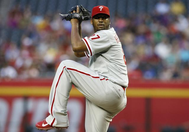Philadelphia Phillies' Roberto Hernandez throws a pitch against the Arizona Diamondbacks during the first inning of a baseball game on Friday, April 25, 2014, in Phoenix. (AP Photo/Ross D. Franklin)
