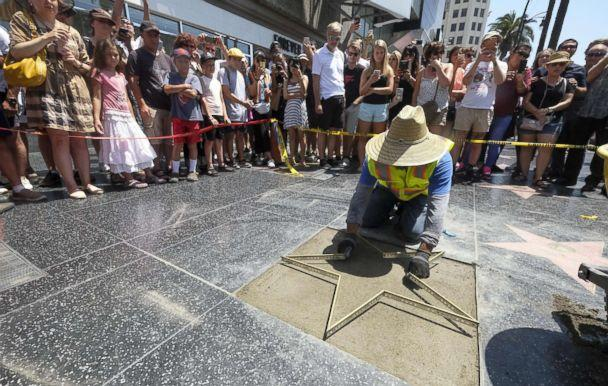 PHOTO: Workers repair the Donald Trump's star on the Hollywood Walk of Fame in Los Angeles on July 25, 2018. Trump's star was destroyed Wednesday morning by a man with a pick ax, the second time in less than two years the star was vandalized. (Ringo Chiu/Splash News via Zuma Press)