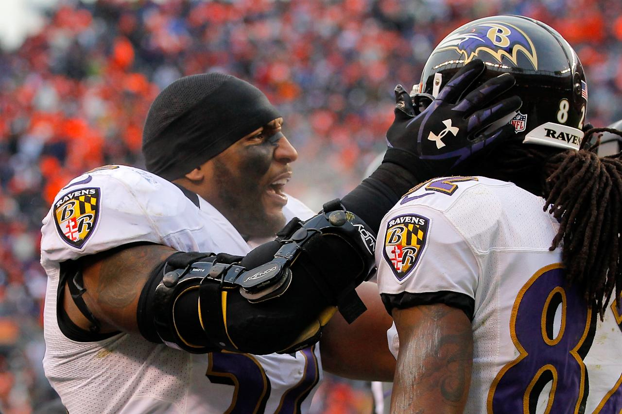 DENVER, CO - JANUARY 12:  (L-R) Ray Lewis #52 of the Baltimore Ravens congratulaes Torrey Smith #82 after Smith scored a 32-yard touchdown reception in the second quarter against the Denver Broncos during the AFC Divisional Playoff Game at Sports Authority Field at Mile High on January 12, 2013 in Denver, Colorado.  (Photo by Doug Pensinger/Getty Images)