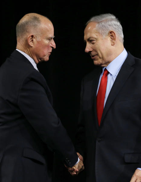 California Gov. Jerry Brown, left, shakes hands with Israeli Prime Minister Benjamin Netanyahu, right, after signing an agreement to expand cooperation at the Computer History Museum Wednesday, March 5, 2014, in Mountain View, Calif. Netanyahu is visiting California, trading a focus on the geopolitics of the Middle East for a Hollywood screening and visits with Silicon Valley tech entrepreneurs. (AP Photo/Eric Risberg)