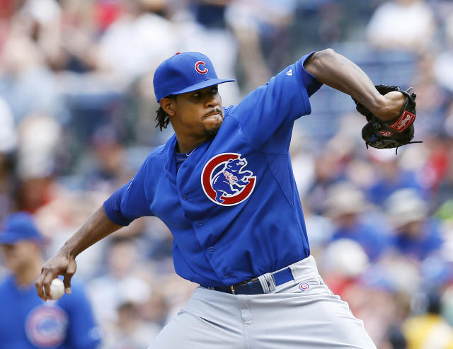 Chicago Cubs starting pitcher Edwin Jackson work against the Atlanta Braves in the first inning of a baseball game on Sunday, May 11, 2014, in Atlanta. (AP Photo/John Bazemore)