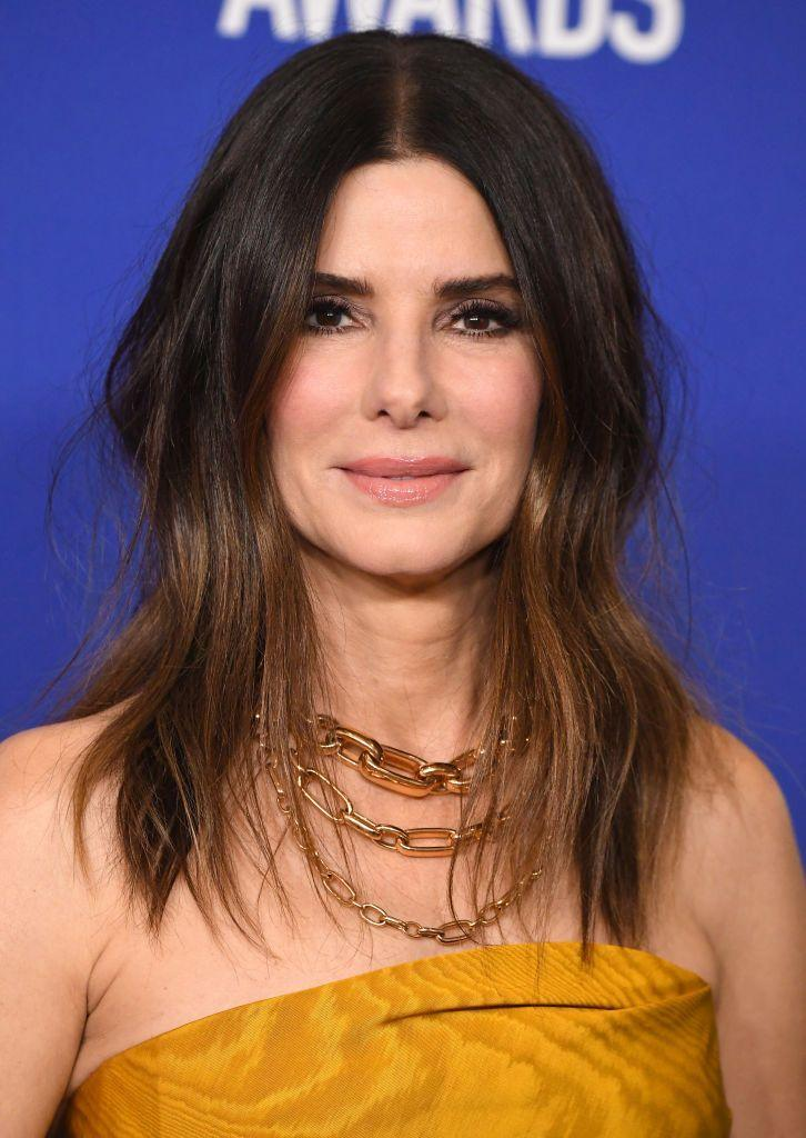 """<p><strong>Sandra Bullock's</strong> messy lob is the ultimate beachy hair inspiration. Subtle <a href=""""https://www.goodhousekeeping.com/beauty/hair/g2942/ombre-hair-color-ideas/"""" rel=""""nofollow noopener"""" target=""""_blank"""" data-ylk=""""slk:ombré"""" class=""""link rapid-noclick-resp"""">ombré </a>chestnut highlights help frame her face. </p><p><a class=""""link rapid-noclick-resp"""" href=""""https://go.redirectingat.com?id=74968X1596630&url=https%3A%2F%2Fwww.sephora.com%2Fproduct%2Fpro-1-25-P451923&sref=https%3A%2F%2Fwww.goodhousekeeping.com%2Fbeauty%2Fhair%2Fg34691983%2Fchestnut-hair-color-ideas%2F"""" rel=""""nofollow noopener"""" target=""""_blank"""" data-ylk=""""slk:SHOP WAVING IRON"""">SHOP WAVING IRON</a></p>"""
