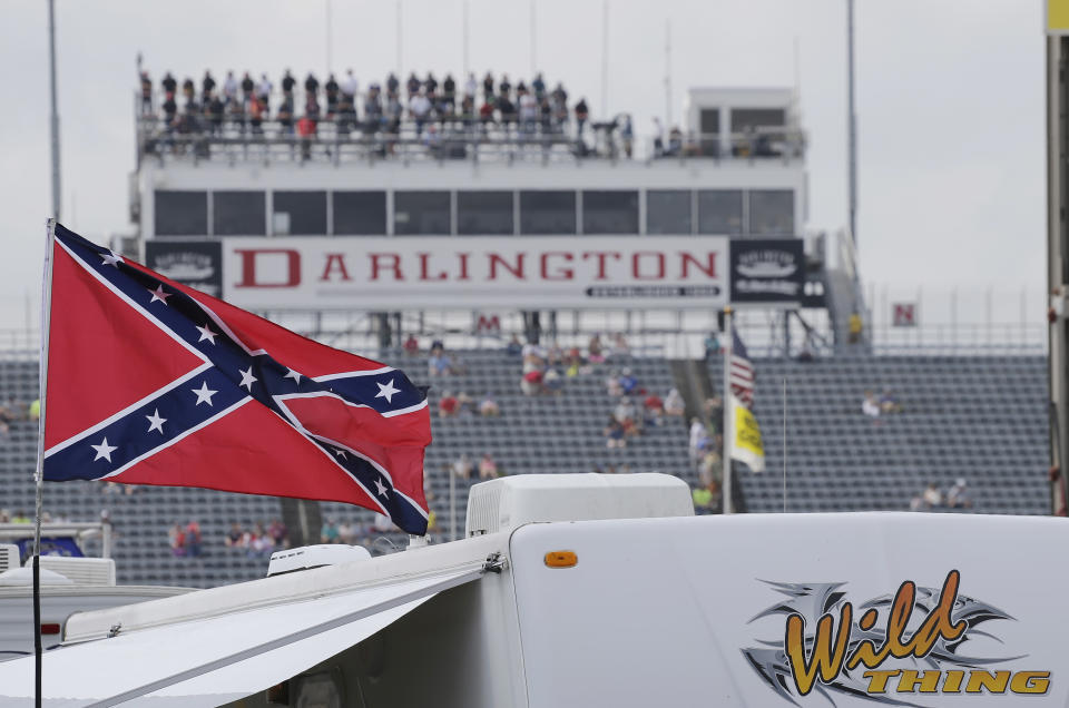 A Confederate flag flies in the infield before a NASCAR Xfinity auto race at Darlington Raceway in Darlington, S.C., Saturday, Sept. 5, 2015. (AP Photo/Terry Renna)