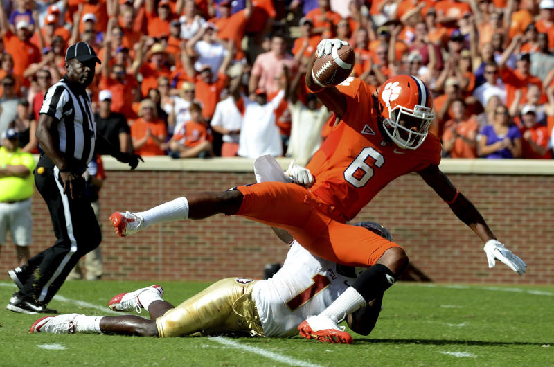 Clemson wide receiver DeAndre Hopkins (6) is tackled by Florida State cornerback Mike Harris (1) after pulling in a 50-yard reception in the first quarter of an NCAA college football game, Saturday Sept. 24, 2011, at Memorial Stadium in Clemson, S.C.  (AP Photo/ Richard Shiro)