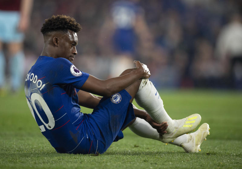 LONDON, ENGLAND - APRIL 22: Callum Hudson-Odoi of Chelsea feels his right achilles after falling to the ground during the Premier League match between Chelsea FC and Burnley FC at Stamford Bridge on April 22, 2019 in London, United Kingdom. (Photo by Visionhaus/Getty Images)