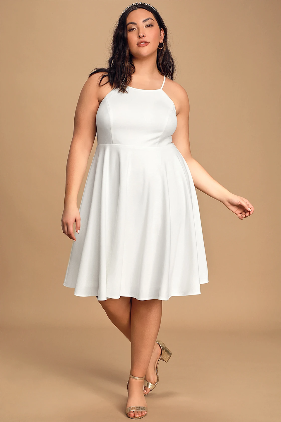 """<h2>Lulus Irresistible Charm White Midi Dress</h2><br><strong><h3>Best Plus-Size Bride Wedding Rehearsal Dress </h3></strong><br><strong>Sizes Available: XXS-2X </strong> <br>This dress is simple, flowy, and white — which is to say, exactly what everyone wants in a rehearsal dinner get-up. Some plus-size reviewers cautioned that the top of the frock can be a bit tight on larger chests, but that the length and weight of the fabric are both on point.<br><br>""""A little tight up top, if you're a DD (like me), but everything else about the dress, is PERFECT. Nice length (hits me above the knee @ 5'11"""") and has a nice weight to it so in the wind the dress won't fly up. Have a great feeling this dress will be my go-to, as I've already dressed it up and down!"""" <em>–Katice J., Size 3X</em><br><br><em>Shop </em><strong><em><a href=""""https://www.lulus.com/products/irresistible-charm-white-midi-dress/607602.html"""" rel=""""nofollow noopener"""" target=""""_blank"""" data-ylk=""""slk:Lulus"""" class=""""link rapid-noclick-resp"""">Lulus</a></em></strong><br><br><strong>Lulus</strong> Irresistible Charm White Midi Dress, $, available at <a href=""""https://go.skimresources.com/?id=30283X879131&url=https%3A%2F%2Fwww.lulus.com%2Fproducts%2Firresistible-charm-white-midi-dress%2F607602.html"""" rel=""""nofollow noopener"""" target=""""_blank"""" data-ylk=""""slk:Lulus"""" class=""""link rapid-noclick-resp"""">Lulus</a>"""