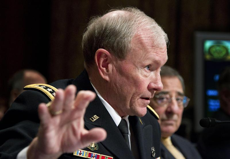 Joint Chiefs Chairman Gen. Martin Dempsey, accompanied by Defense Secretary Leon Panetta, testifies on Capitol Hill in Washington, Tuesday, Feb. 28, 2012, before the Senate Budget Committee hearing on the Defense Department's fiscal 2013 budget. (AP Photo Manuel Balce Ceneta)