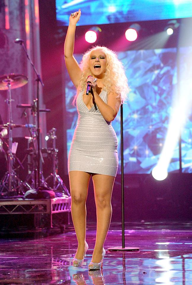 LOS ANGELES, CA - NOVEMBER 20:  Singer Christina Aguilera peforms onstage at the 2011 American Music Awards held at Nokia Theatre L.A. LIVE on November 20, 2011 in Los Angeles, California.  (Photo by Jeff Kravitz/AMA2011/FilmMagic)